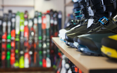 Sport equipment shop interior with large assortment of modern ski boots