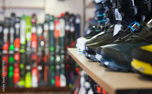 Fotografie, Obraz Sport equipment shop interior with large assortment of modern ski boots