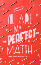 """Text """"""""you Are My Perfect Match"""""""" On Red Backgorund With Bunch Of Fire Matches."""