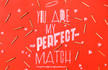 "White Text """"you Are My Perfect Match """" On Red Background With Bunch Of Fire Matches."