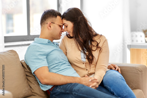 Fototapeta love, relationships and people concept - happy couple at home obraz