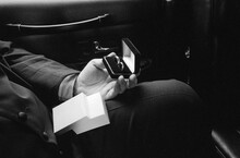 Best Man Holding Rings In Limo On Way To Church