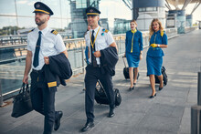Aircrew With Travel Suitcases ...