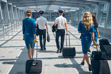 Airline Workers Carrying Trave...
