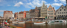 Ghent, Belgium: Panoramic View On Canal Boats And Many Visitors At Graslei And Korenlei, Famous For Their Historic Facades.