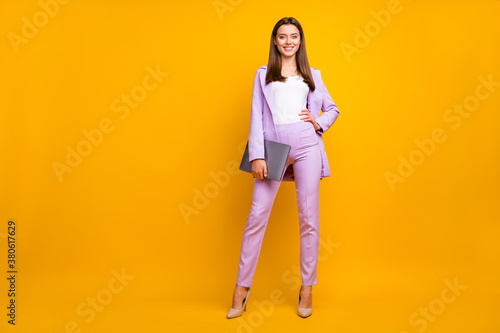 Fototapeta Full size photo of beautiful business ceo lady holding notebook hands ready for corporate conference wear stylish purple office costume isolated yellow color background obraz