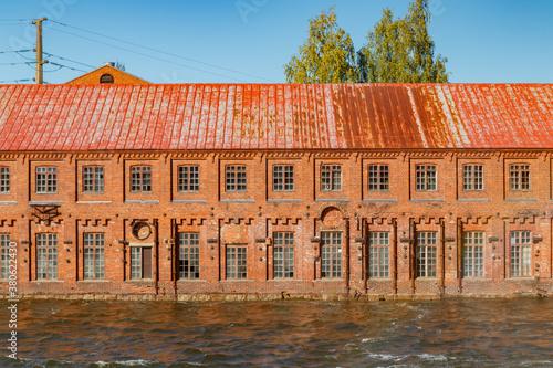 Kouvola, Finland - 15 September 2020: Old red brick buildings of Upm factory on rapids Kuusankoski.