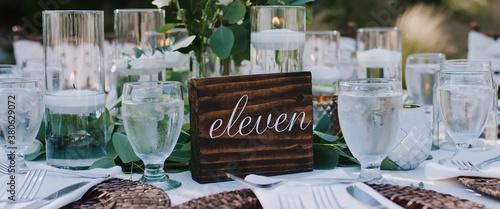 Wooden plaque on the wedding table, festive banquet with glasses Tapéta, Fotótapéta