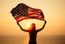 Woman Holding USA Flag And Loo...