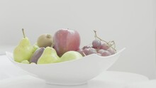 Green Pears, Red Apples And Purple Grapes Are Placed On A White Bowl In A Hotel Room.