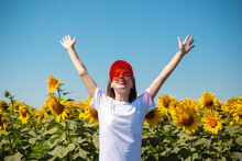 Young Woman In A Red Sun Visor...