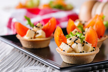 Delicious Snack Tartlets On Rustic Wooden Background