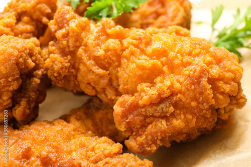 Fototapeta Tasty deep fried chicken pieces served on table, closeup