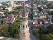 Aerial Shot Of The City Of Charleston, South Carolina With The Steeple Of St Philips Church In The Foreground.