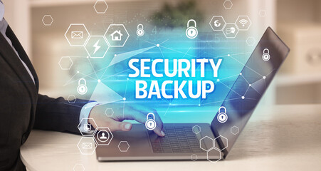 SECURITY BACKUP inscription on laptop, internet security and data protection concept, blockchain and cybersecurity