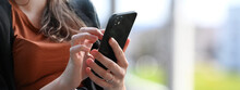 Young Beautiful Woman Using Smartphone For Social Media Contacts