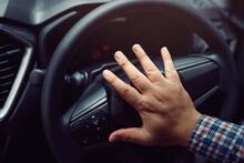 Man Pushing Horn While Driving...