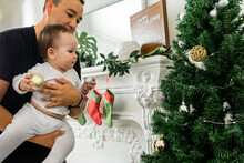 Father And Son Decorate Tree