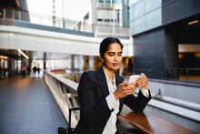 Indian Business Woman Using Ce...