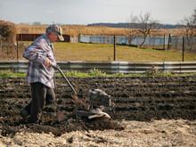 Male Farmer Cultivates The Land