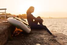 Dreamy Paddleboarder Sitting O...
