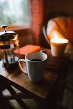 Coffee Mug And Burning Candle