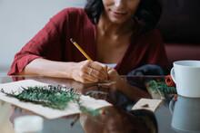 Brunette Woman Writing A Chris...
