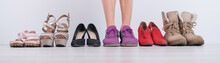 The Woman Chooses Comfortable Shoes. Widescreen Photo.