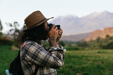Man Taking Photographs In Nature