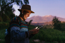 Handsome Man Using Phone In Nature