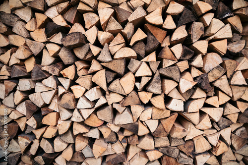 Stacked wood logs - 380708848