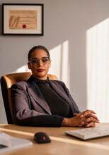 Businesswoman Sitting At A Des...