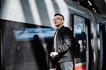 Businessman Waiting For Train ...