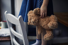 Child Holding A Teddy Bear
