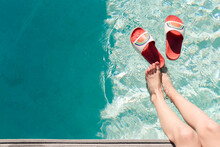 Flip Flops And Feet By Pool