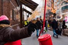 Salvation Army Worker Ringing The Bell In Downtown Chicago