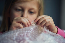 Child Popping Bubble Wrap