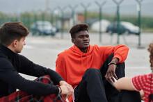 Black Man Speaking With Friend...