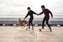 Modern Couple On Skateboards F...