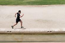 Athlete Running On Stone Path ...