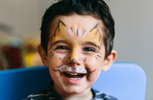 Adorable Boy With Infant Makeup On His Face.