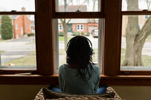 Black Girl With Headphones Looking Out The Window
