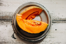 Fresh Cantaloupe On A White Wooden Background