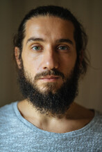 Portrait Of A Young Dark-haired Guy With A Beard