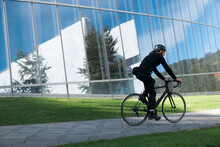 Urban Cyclist In Rides In Busi...