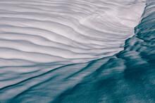 Snow Creates Patterns When It Melts Under The Warm Sun
