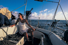 A Sailor Is Holding The Tiller While Sailing