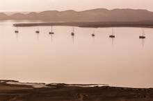 7 Anchored Boats In Hazy Light