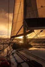 Sailboat Sailing Towards Sunset