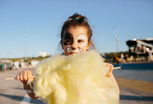 Kid Eating A Cotton Candy
